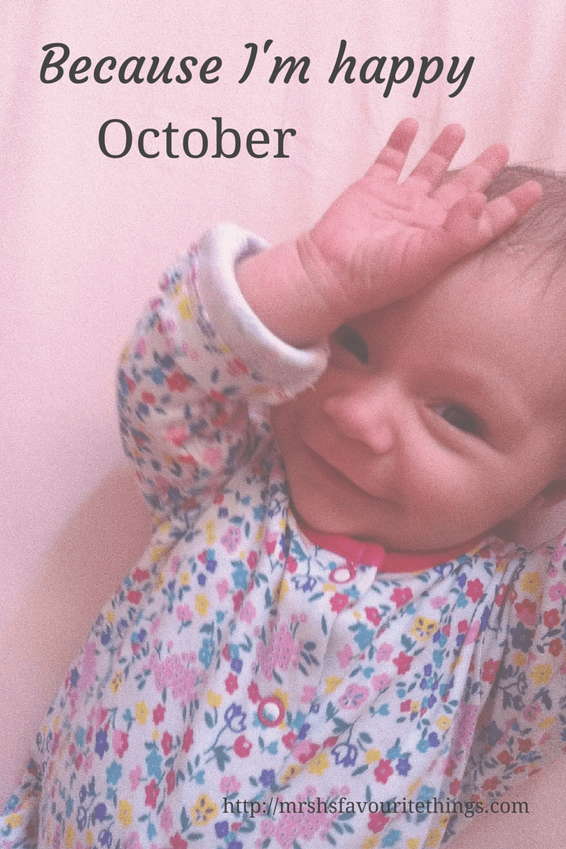 "A baby girl lying in her cot wearing a sleeping suit and smiling_with the title ""Because I'm happy - October""_Mrs H's favourite things"