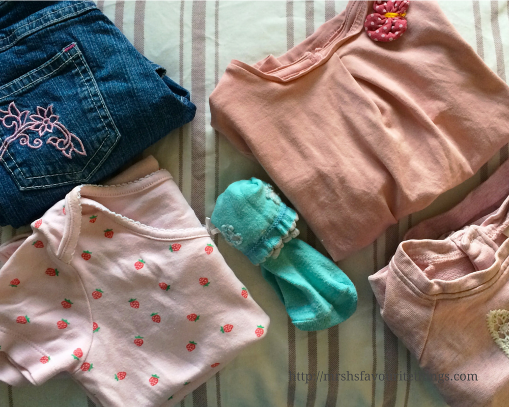 A complete toddler girl outfit - including jeans, a body suit, a long sleeved t-shirt, a sweatshirt and a pair of socks, sorted for From a Mother to Another - the JoJo Maman Bébé charity campaign - Mrs H's favourite things