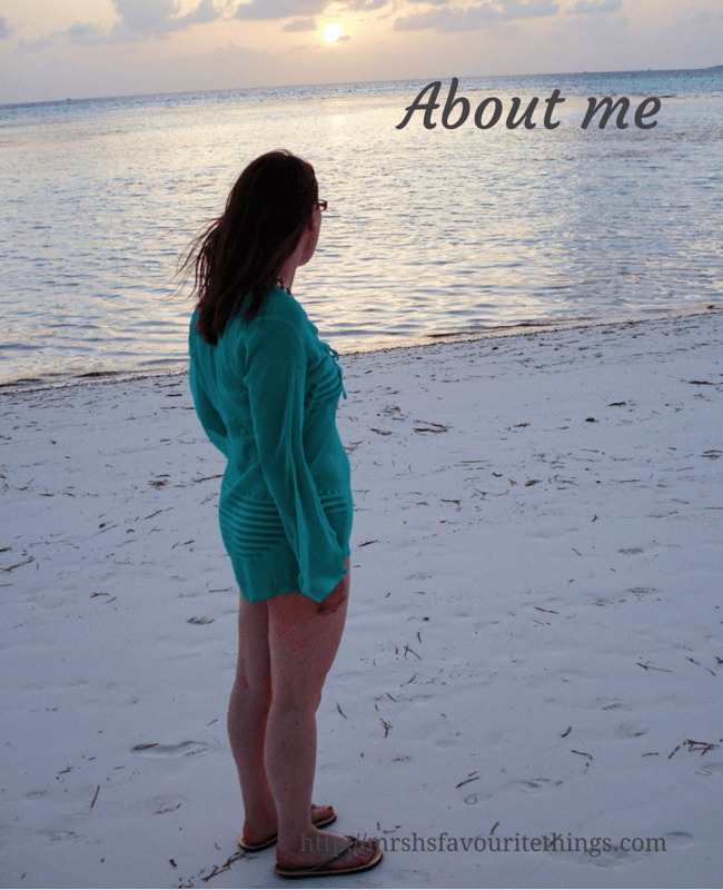 "A young woman with long brown hair wearing a bikini and kaftan is standing on a white beach looking out to sea as the sun sets - includes the title ""About me"" - Mrs H's favourite things"
