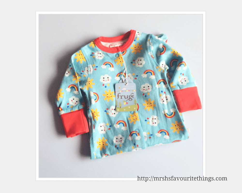 A photograph of the Sunny Days BabyGrow from Frugii _ a turquoise babygrow with a pattern of colourful suns, clouds and rainbows - 24 weeks pregnant - a huge milestone - Mrs H's favourite things
