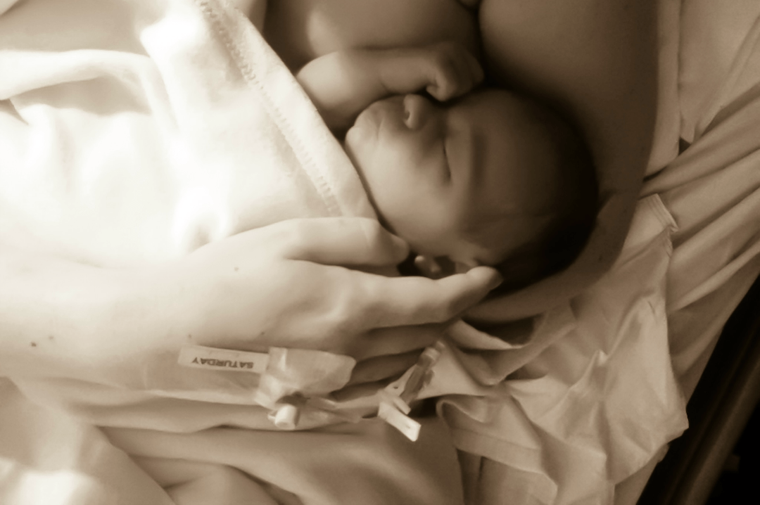A sepia tinted photograph of a newborn baby girl having skin to skin and lying in her Mummy's arms - The Sadness of Not Being Able to Breastfeed My Babies - Mrs H's favourite things