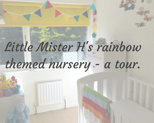 "A faded photography of a rainbow themed nursery. The room includes white walls and furniture and many rainbow coloured accessories _ the post includes the title ""Little Mister H's rainbow themed nursery - a tour"" - Mrs H's favourite things"