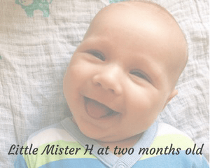 """A faded photograph of a smiling baby boy who is wearing a light green, light blue and white striped babygrow and is lying on a white and blue patterned muslin - includes the title of the blog post """"Little Mister H at two months old"""" - Mrs H's favourite things"""