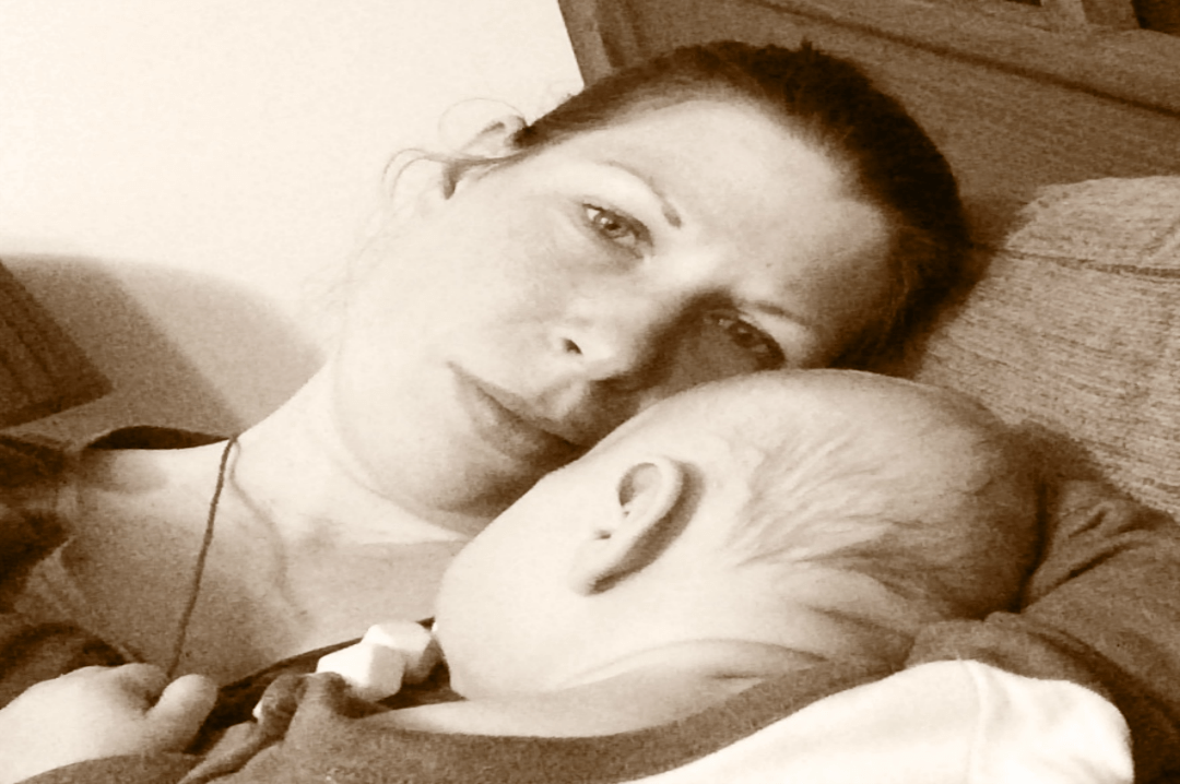 A sepia photograph of a mother holding her sleeping baby in her arms_One of those days- Mrs H's favourite things