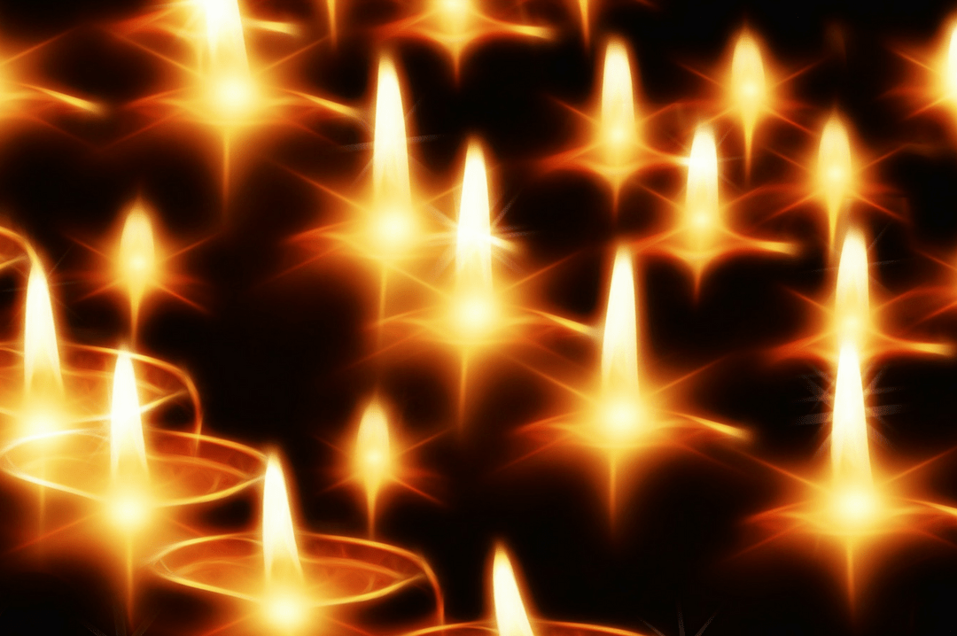 A photograph of candles shining brightly in the darkness - Be the light - Mrs H's favourite things
