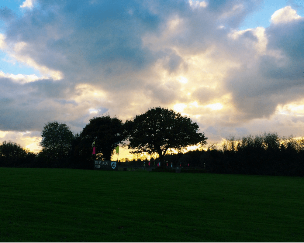 A photograph of the sun beginning to set over the Tournament Field at Bluestone National Park Resort - Bluestone Wales - A review of the resort and Kingdom of the Elves _ Mrs H's favourite things