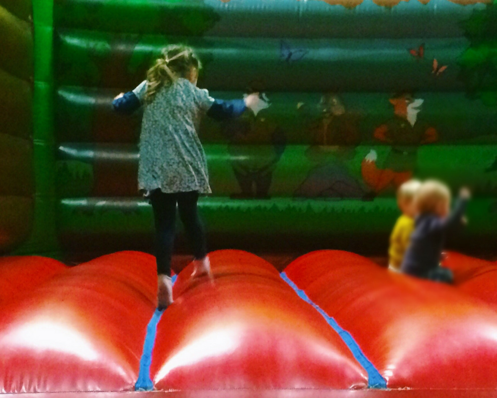 A little girl bouncing on a bouncy castle at the Adventure Centre in Bluestone National Park Resort - A review of the resort and Kingdom of the Elves _ Mrs H's favourite things