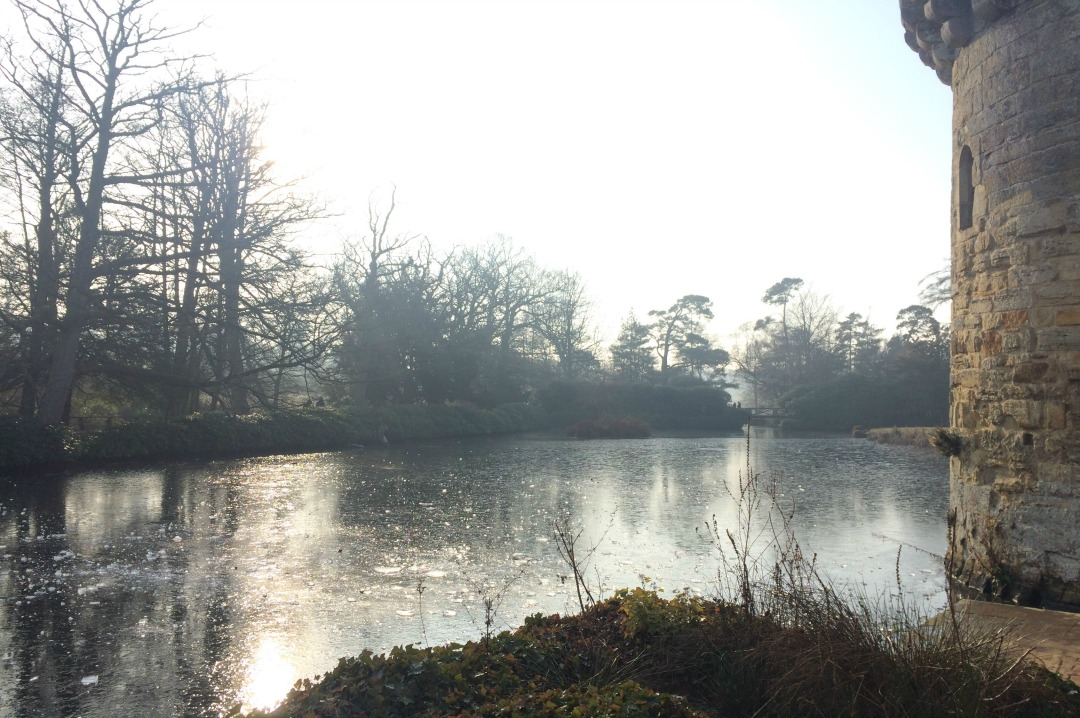 A photograph of a wintery scene and a frozen moat around a castle - 5 ways to beat the January blues _ Mrs H's favourite things