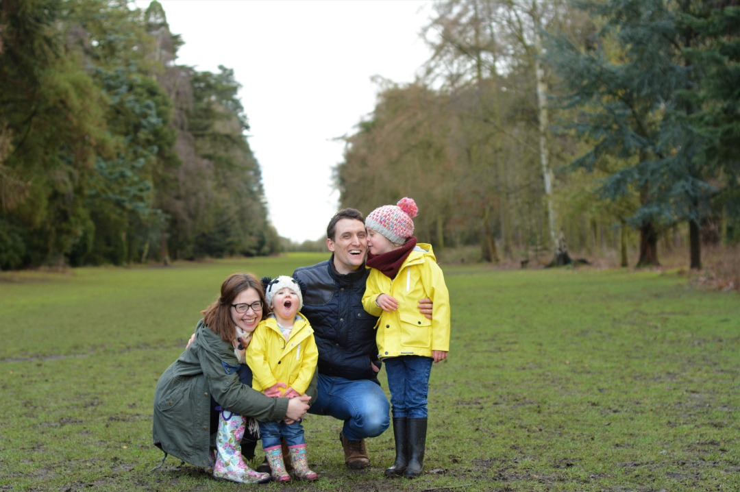 A family photograph of Laura from Little Ladies Big World and her two daughters Eva and their rainbow baby Roma and her husband - My Rainbow Baby - featuring Little Ladies Big World