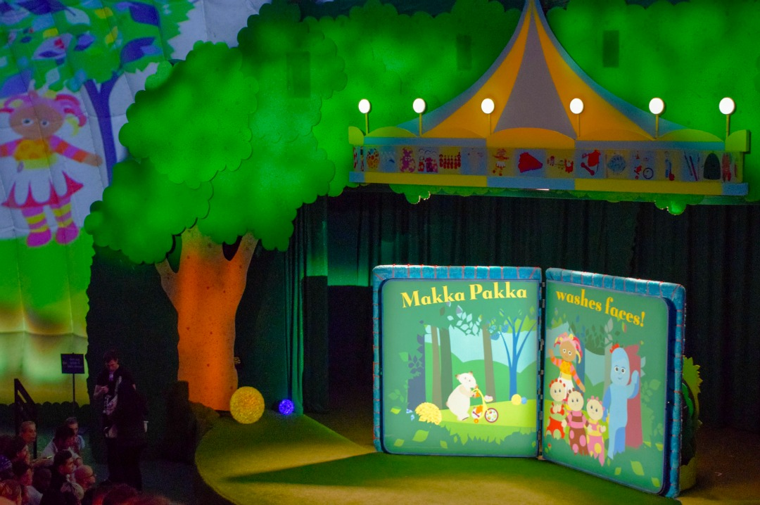 "A shot of the stage from In the Night Garden Live showing the open book that says ""Makka Pakka washes faces"" - this is the main story of the Pinky Ponk show of In the Night Garden Live - photograph featured in the post In the Night Garden Live a review by Mrs H's favourite things"
