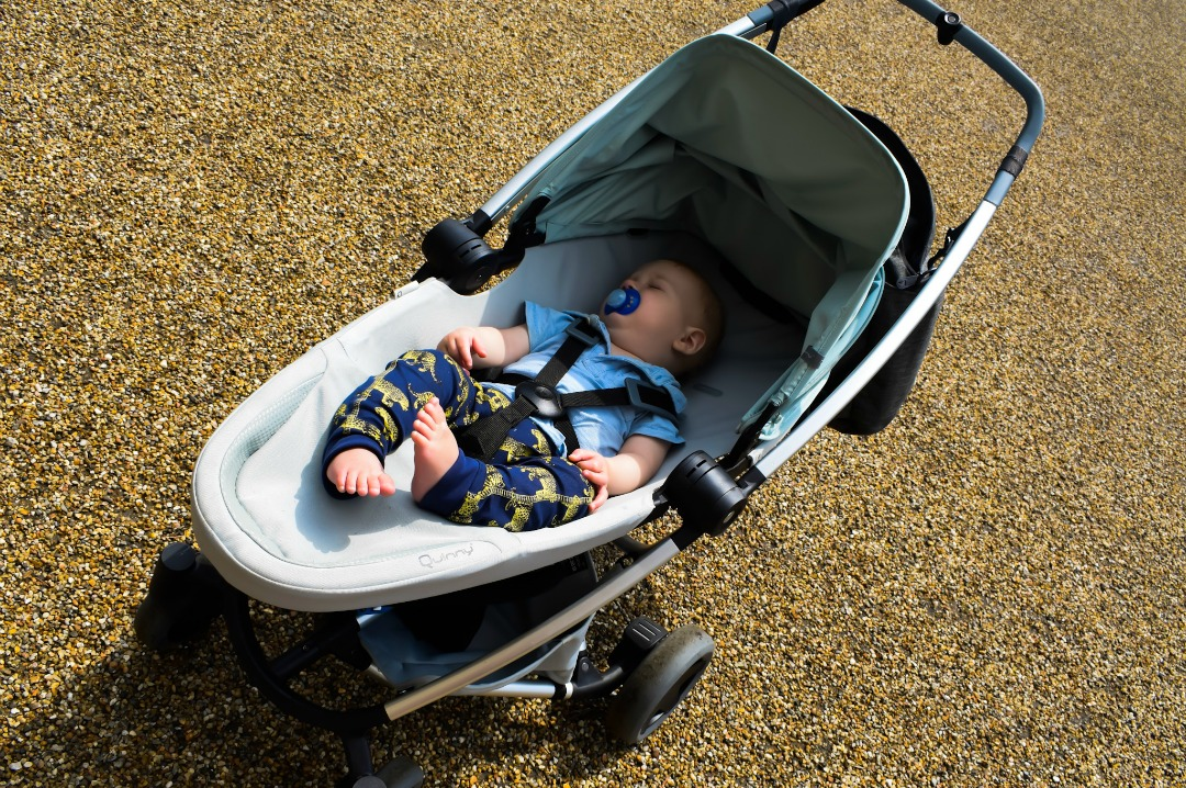A photograph of a baby boy sleeping in a fully reclined forward facing Quinny Zapp Flex Plus in frost on grey - A Day at Dover Castle with the Quinny Zapp Flex Plus - Mrs H's favourite things