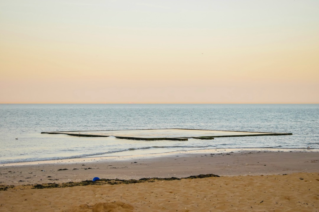 A photograph taken as the sun was setting of the paddling pool of Viking Bay in Broadstairs, Kent - Our week in Broadstairs, Kent - Mrs H's favourite things