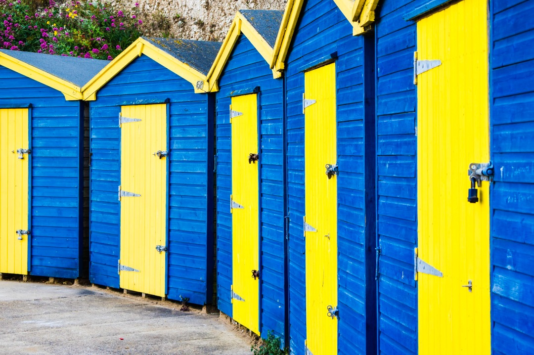 A photograph of the blue and yellow beach huts beside Viking Bay, Broadstairs, Kent - Our week in Broadstairs, Kent - Mrs H's favourite things