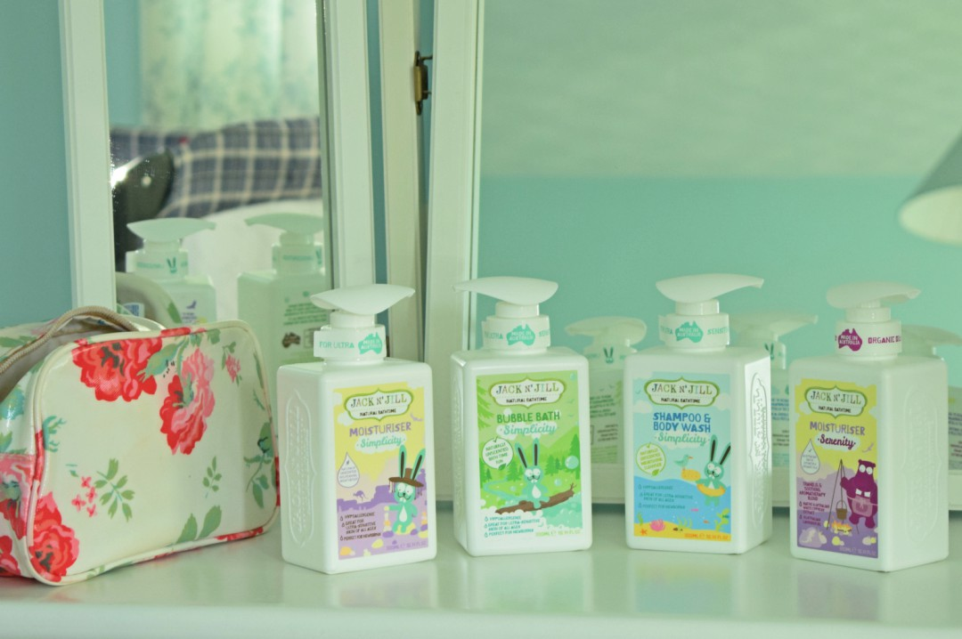 A photograph of four products from Jack N' Jill's new natural bathtime range - the photograph includes the Bath Bubbles, Shampoo & Body Wash and Moisturiser from the Simplicity range and the moisturiser from the Serenity range - Making a Splash with Jack N' Jill's New Natural Bathtime Range - A review & giveaway - Mrs H's favourite things
