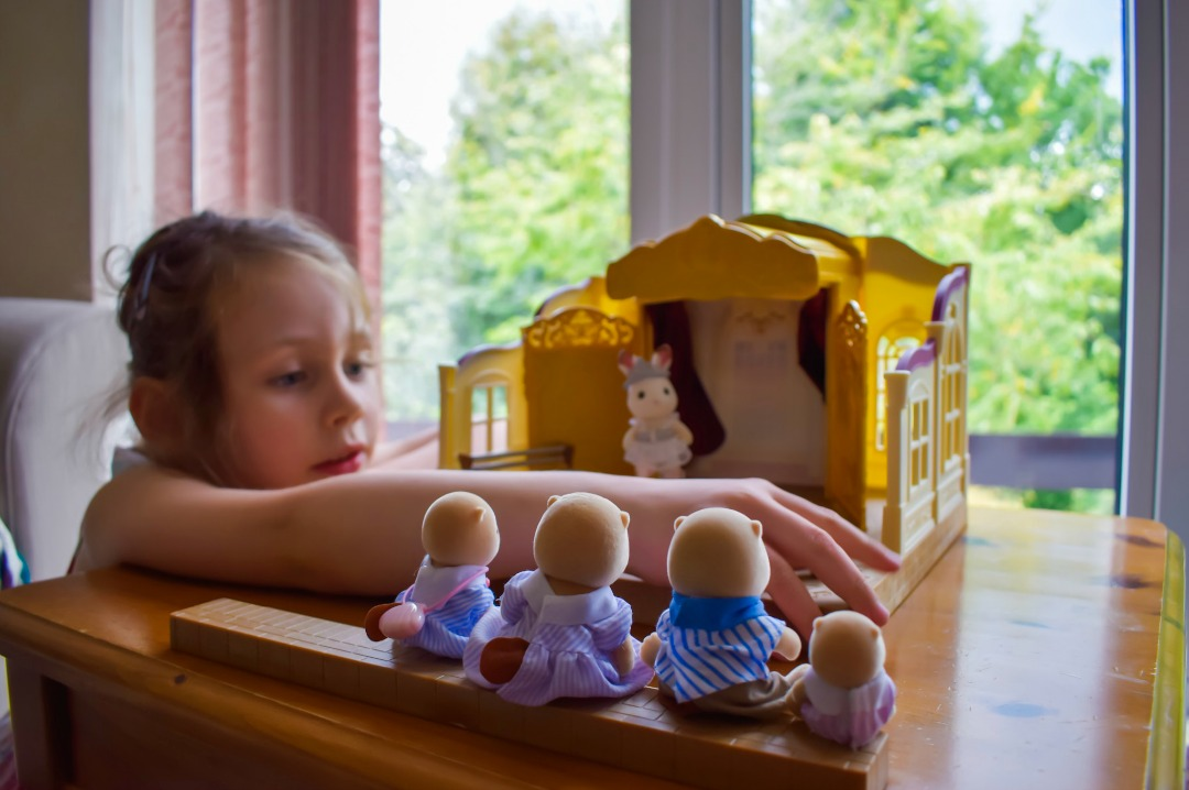 A four year old girl playing with the Sylvanian Families Ballet Theatre Playset and Sea Otter Family - Sylvanian Families Ballet Theatre Playset and Sea Otter Families - A Review - Mrs H's favourite things