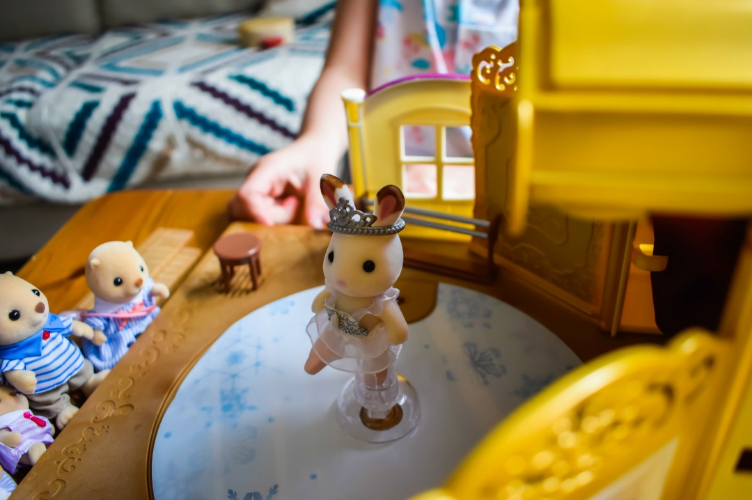 A four year old girl playing with the Sylvanian Families Ballet Theatre Playset and Sea Otter Family - the photograph includes a close up of the ballerina Freya Chocolate the little girl from the Sylvanian Families Chocolate Rabbit Family - Sylvanian Families Ballet Theatre Playset and Sea Otter Families - A Review - Mrs H's favourite things