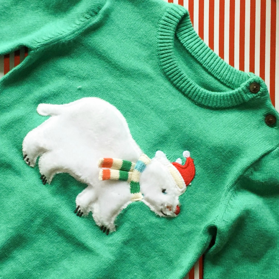 A photograph of a Christmas jumper for a baby boy from Marks & Spencers - the jumper is emerald green and includes an appliqued polar bear - Our Christmas Eve box - what's inside? - Mrs H's favourite things