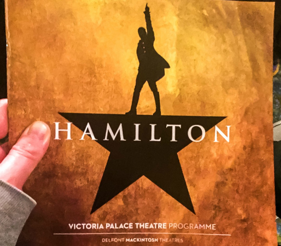 A photograph of a programme from Hamilton the Musical being held up - Our Weekend Happy #1 - A trip to London, Hamilton and Comfort Food - Mrs H's favourite things