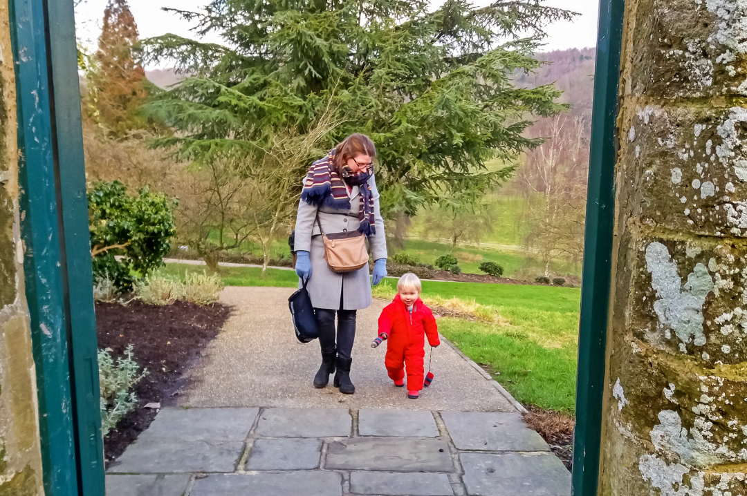 A photograph of her mum and her young son at a National trust property walking and framed by a doorway - How To Make Sure Your Will Is Up To Date - Mrs H's favourite things