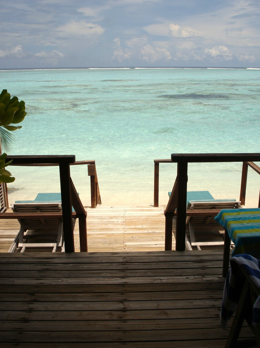 A photograph of the veranda of a water villa that leads down to the Indian Ocean in the Maldives - - Our Travel Bucket List - Mrs H's favourite things