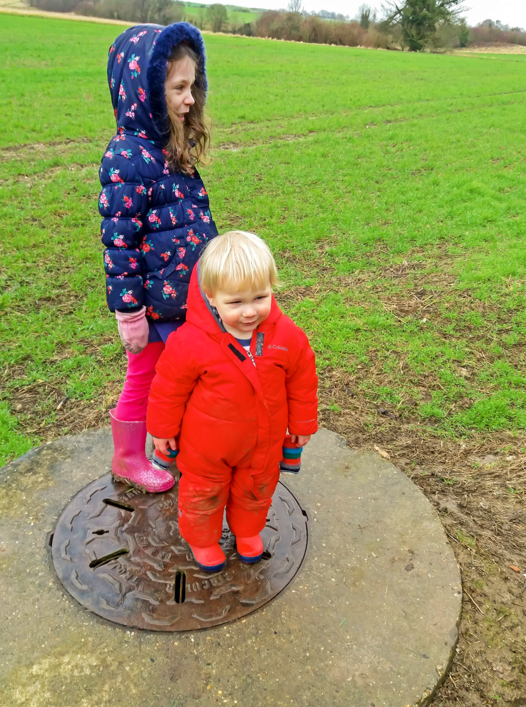 A photograph of a little girl and her baby brother on a muddy walk at Lullingstone Park - Our Weekend Happy #4 - Muddy Walks, an Afternoon Nap & Songs at Dinnertime - Mrs H's favourite things