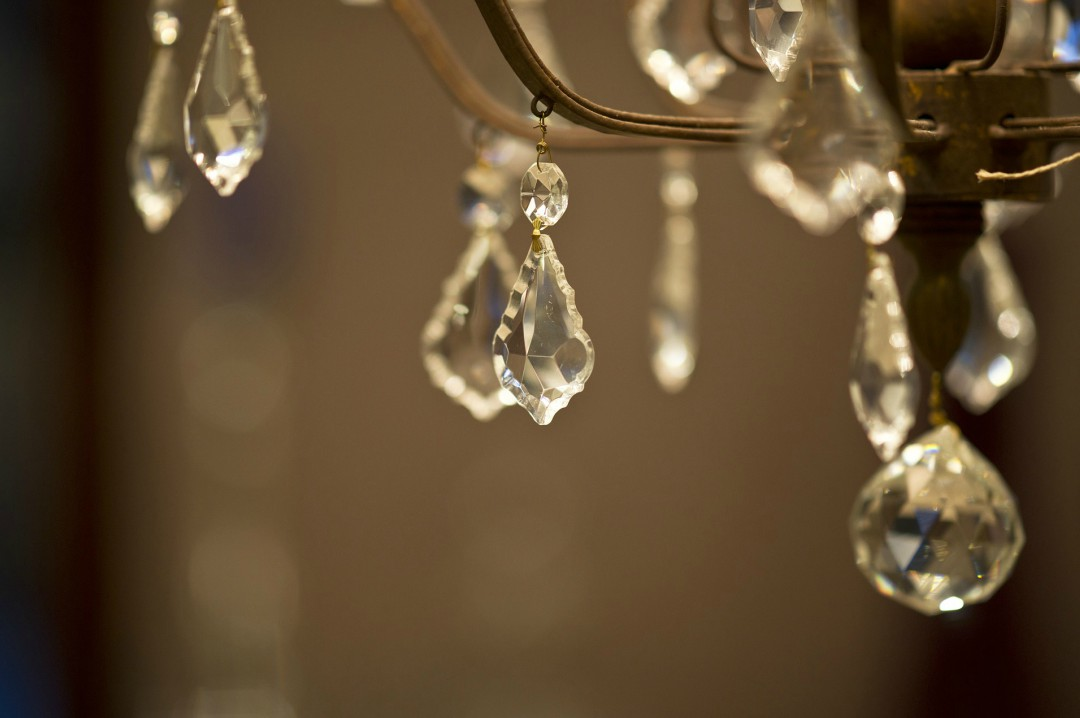 A photograph of the crystal droplets from a hanging chandelier - Reasons To Hang A Chandelier In Your Home - Mrs H's favourite things