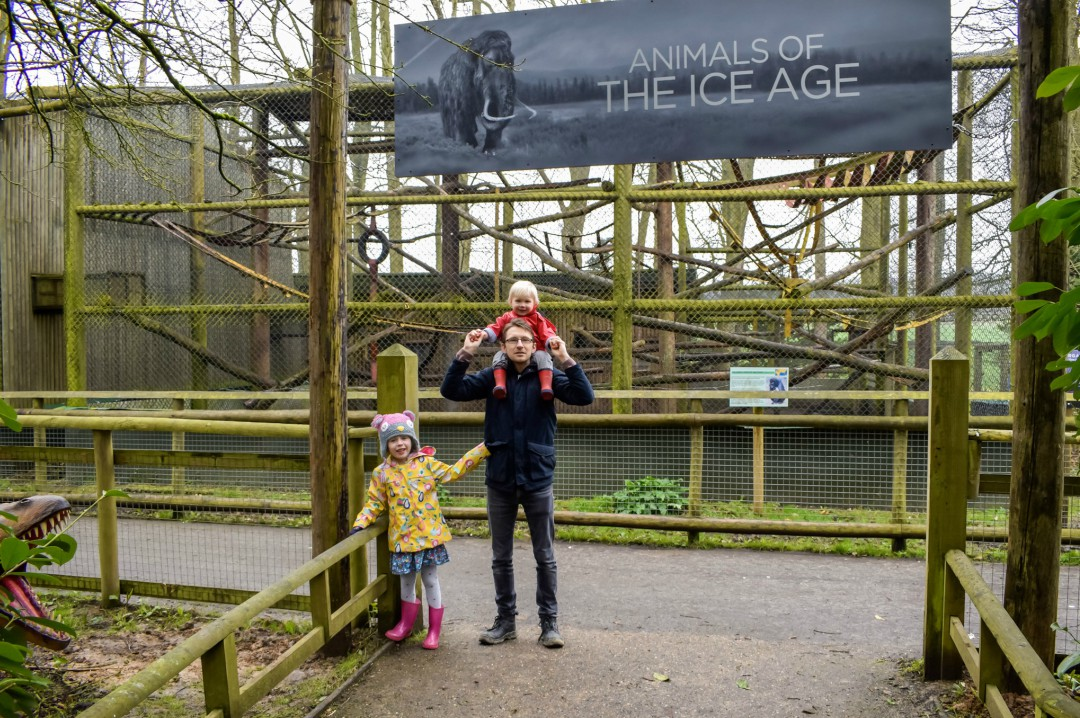 A photo of a Daddy, his daughter and son standing underneath the sign for Animals of the Ice Age at Howletts Wild Animal Park - A Good Friday Trip to see Animals of the Ice Age - Mrs H's favourite things