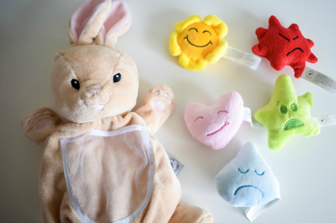 A photograph of the Robbie the rabbit hand puppet and the five focus emotion toys from My First Emotions Box by Skylark Learning - My First Impressions of the My First Emotions Box - Mrs H's favourite things