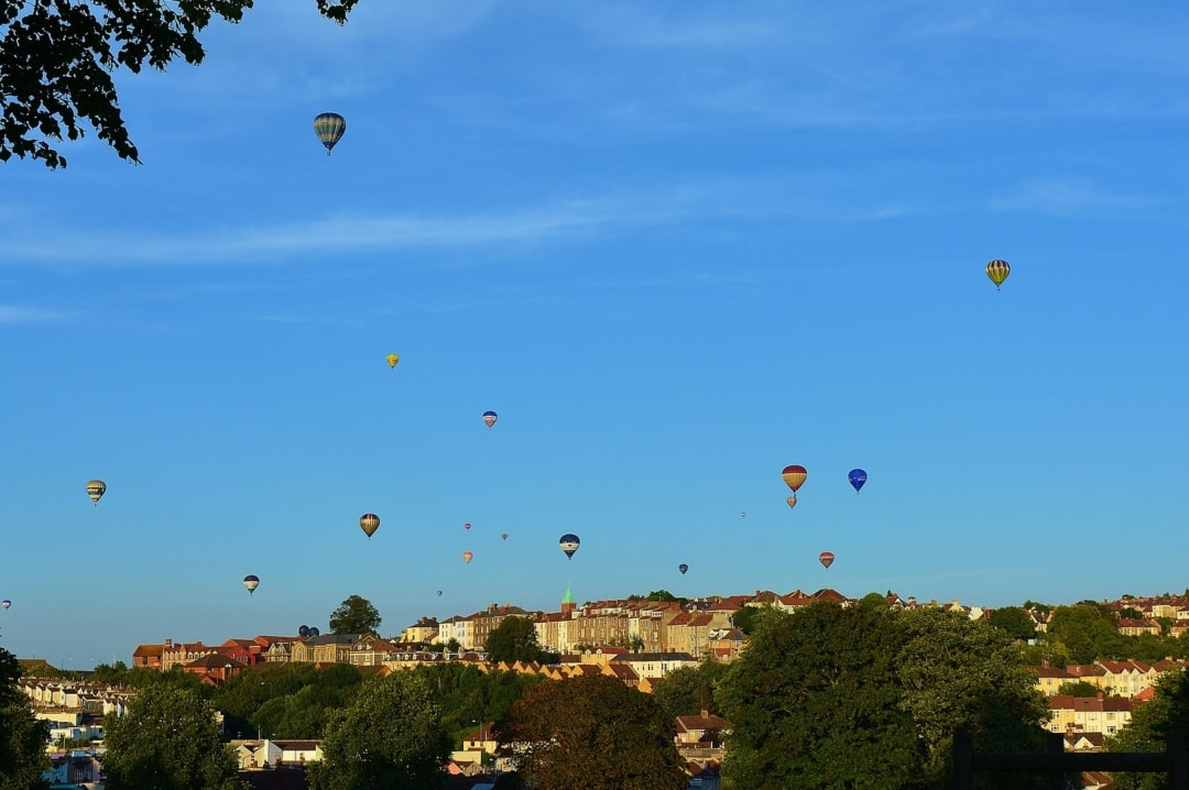 A photograph of hot air balloons from Bristol's International Balloon Fiesta floating in the sky above Bristol - 7 Things To Do In Bristol - Mrs H's favourite things