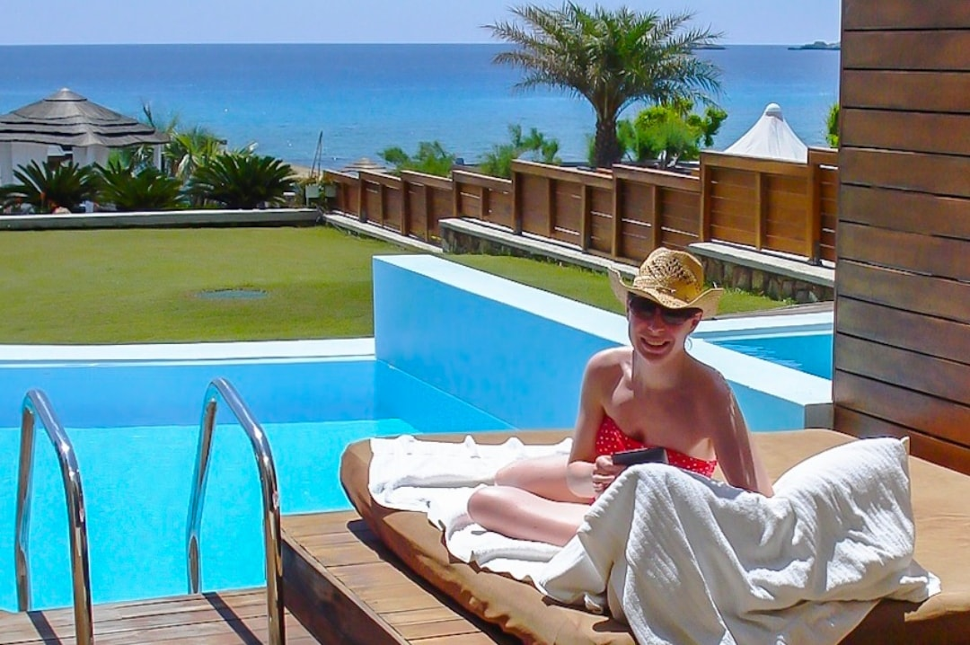 A photograph of a woman on a babymoon in Rhodes with her husband before having a baby - What Is A Babymoon? 5 Reasons Why You Should Have One - Mrs H's favourite things