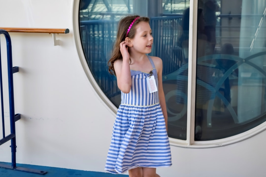 A photograph of a little girl smiling, laughing and dancing onboard the Royal Caribbean Cruise ship the Independence of the Seas - A photograph of the view from the top deck of the Royal Caribbean cruise ship Independence of the Seas on turnaround day in Southampton harbour - 10 Reasons Why A Royal Caribbean Cruise Would Make A Perfect Family Holiday - Mrs H's favourite things