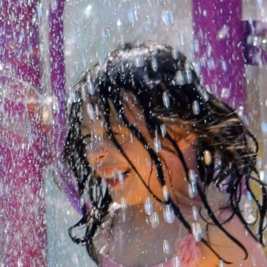 A little girl smiling as she gets soaked at Splashaway Bay on the Royal Caribbean Cruise ship Independence of the Seas - 10 Reasons Why A Royal Caribbean Cruise Would Make A Perfect Family Holiday - Mrs H's favourite things