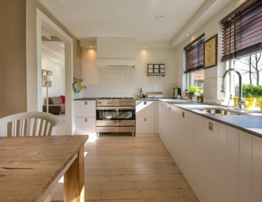A photograph of a smart and large kitchen in a modern home - How Furniture Can Help Sell Your Home - Mrs H's favourite things