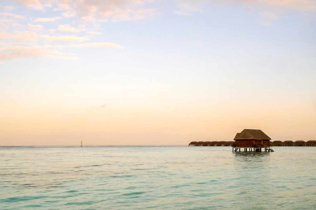 A photo of a water villa at sunset on the Maldivian Island of Meeru - My Favourite Holiday - Our Honeymoon In The Maldives - Mrs H's favurite things