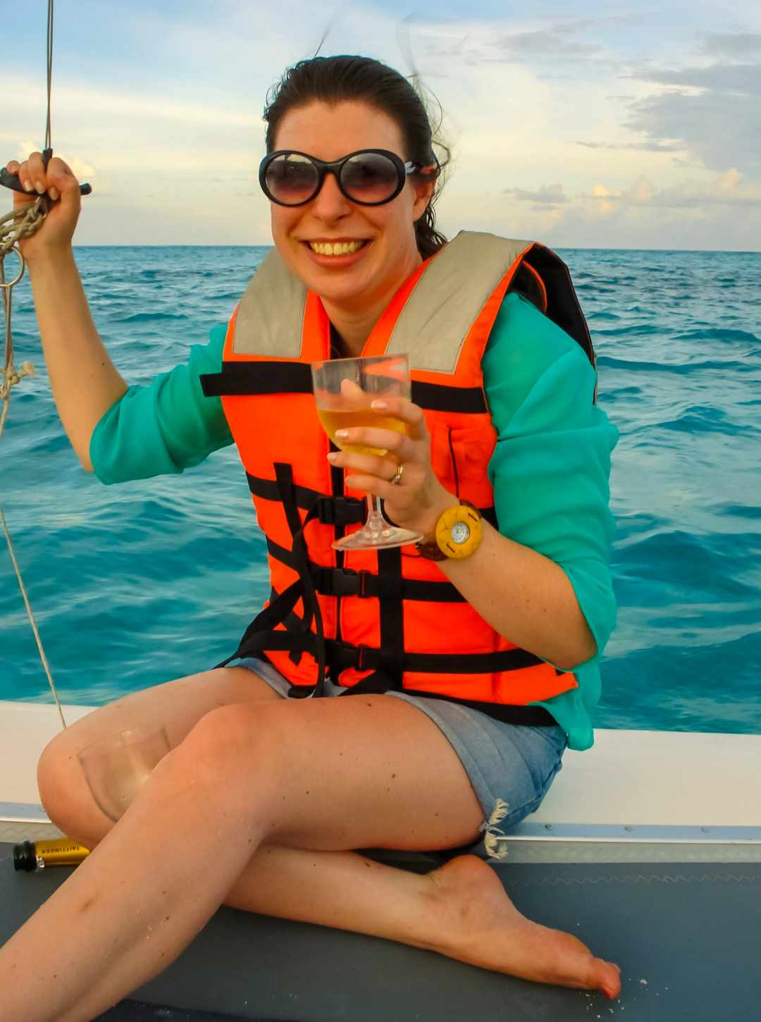 A photograph of a woman on a catamaran in the Indian Ocean - My Favourite Holiday - Our Honeymoon In The Maldives - Mrs H's favourite things