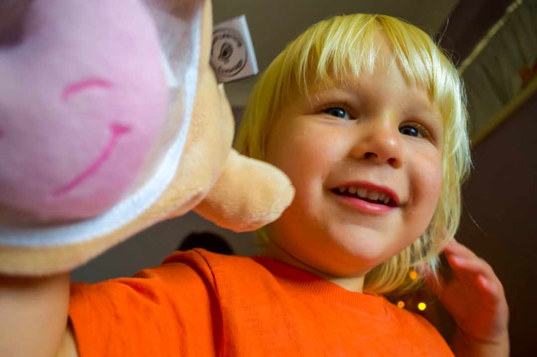 A photograph of a little boy playing with the Robbie the Rabbit puppet from the My First Emotions box - Feeling The Love With Little Mister H and My First Emotions - Mrs H's favourite things