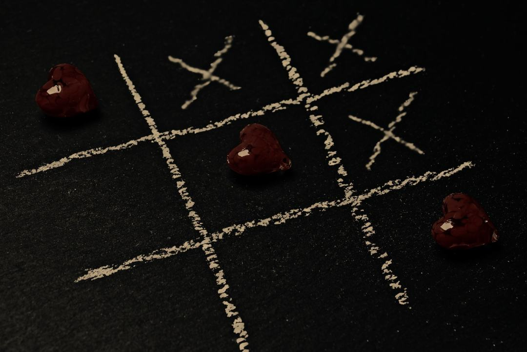 A photograph of a tic tac toe board using crosses and love hearts _ Signs Your Relationship Is In trouble - Mrs H's favourite things