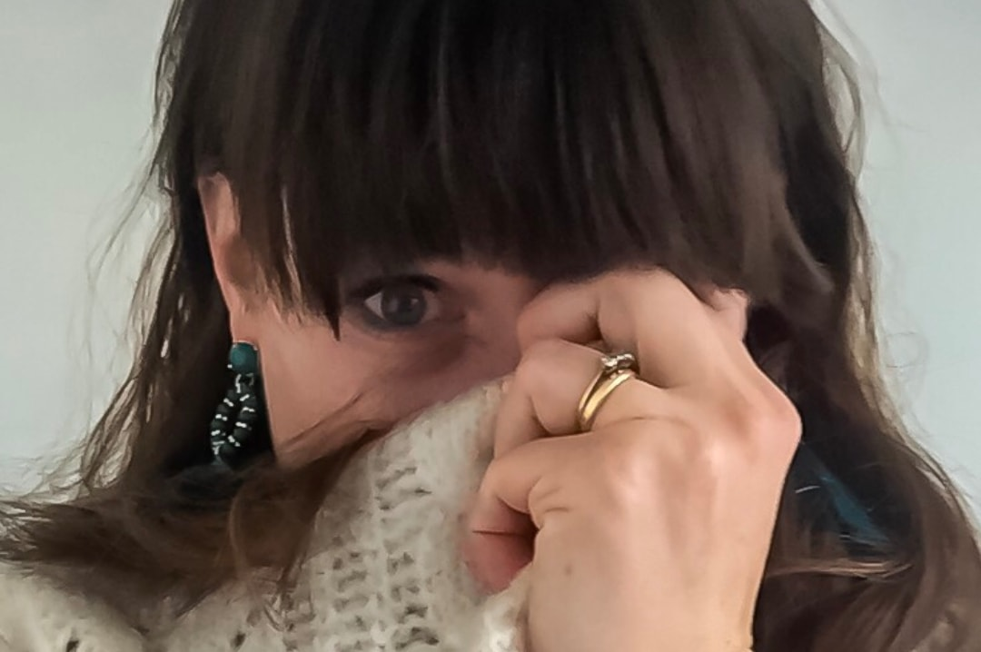 A photograph of a woman covering her mouth with her jumper - Why I Talk About My Depression? Time To Talk Day 2019 - Mrs H's favourite things