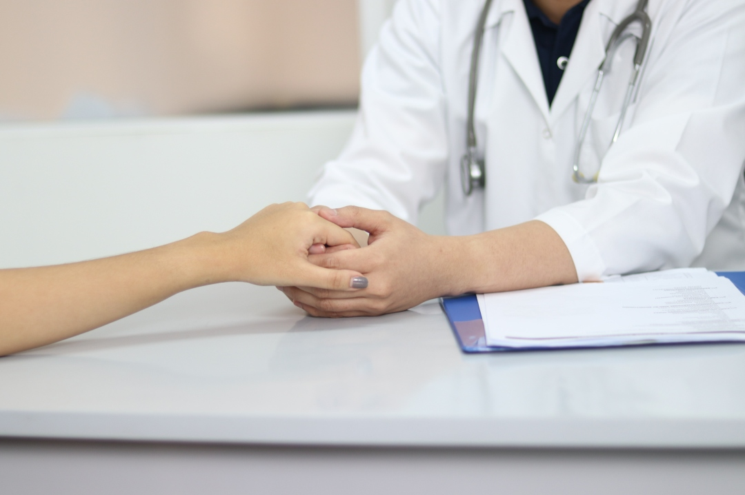 A photograph of a doctor holding a person's hand - Five Immediate Reasons For A Doctor's Visit - Mrs H's favourite things
