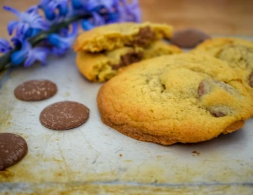 A photograph of three giant chocolate button cookies - Giant Chocolate Button Cookie Recipe - Mrs H's favourite things
