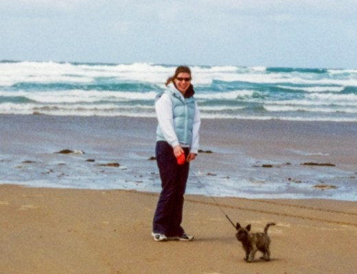 A photo of a 23-year-old girl walking a dog along a beach in Cornwall - An Open Letter To My 23-Year-Old Self - Mrs H's favourite things