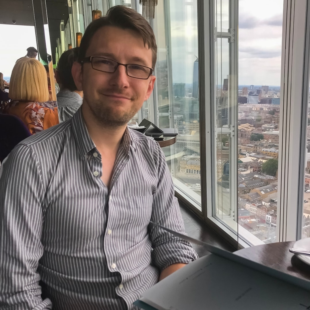A photograph of a man having a meal at the Aqua Shard - A Family Update - Mrs H's favourite things