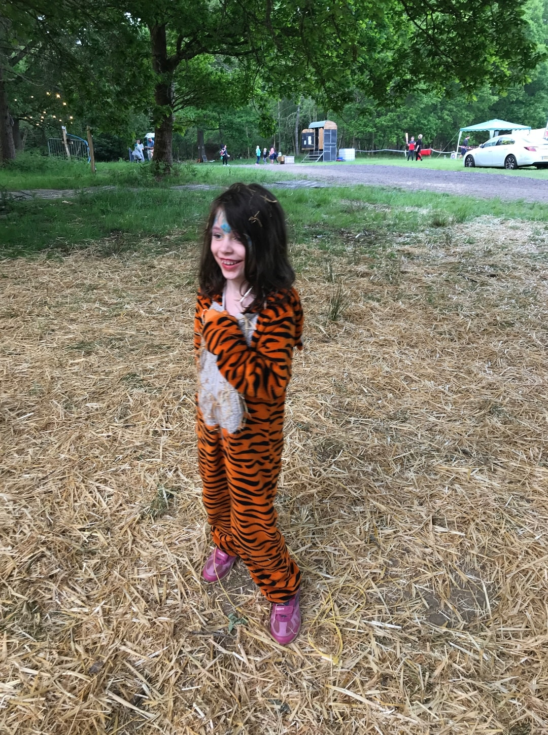 A photograph of a little girl standing in a field of hay at Elderflower Fields Festival - Elderflower Fields: The Perfect Family Festival - Part One - Mrs H's favourite things