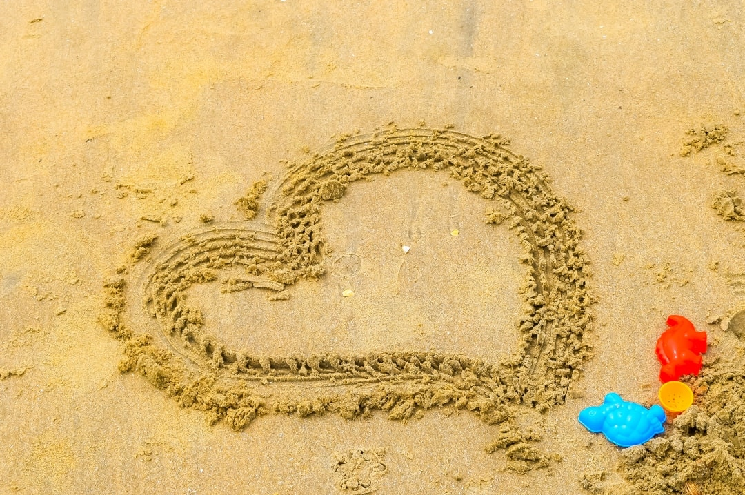 A photograph of a heart drawn in the sand on the beach at Camber Sands - Konfidence Golden Bucket Sand Art Competition 2019 - Mrs H's favourite things