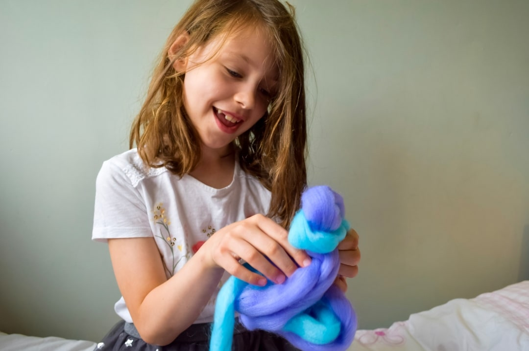 A photograph of a girl playing with a Candylocks Doll - Introducing Candylocks Dolls - A Review - Mrs H's favourite things