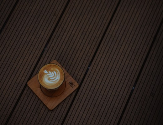 A photograph of a cup of latte on a decking platform - Patio And Decking Ideas For Your Home And Garden - Mrs H's favourite things
