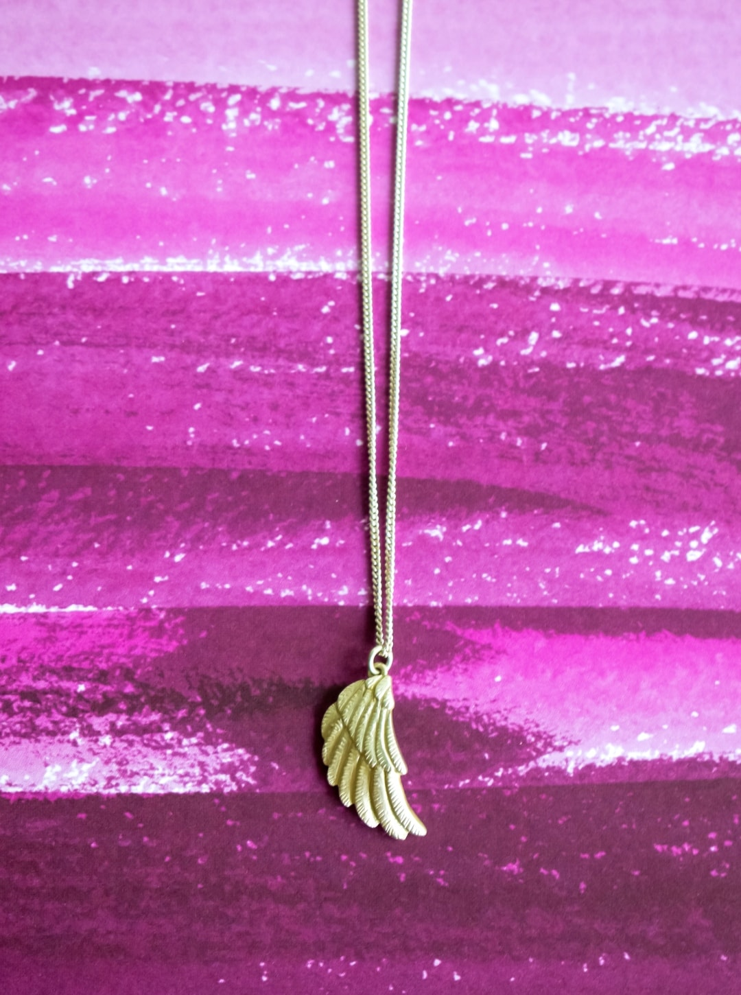 A photograph of a Jana Reinhardt original silver wing necklace - a perfect gift for a baby loss mama - Silver Wing Necklace By Jana Reinhardt - A Review - Mrs H's favourite things