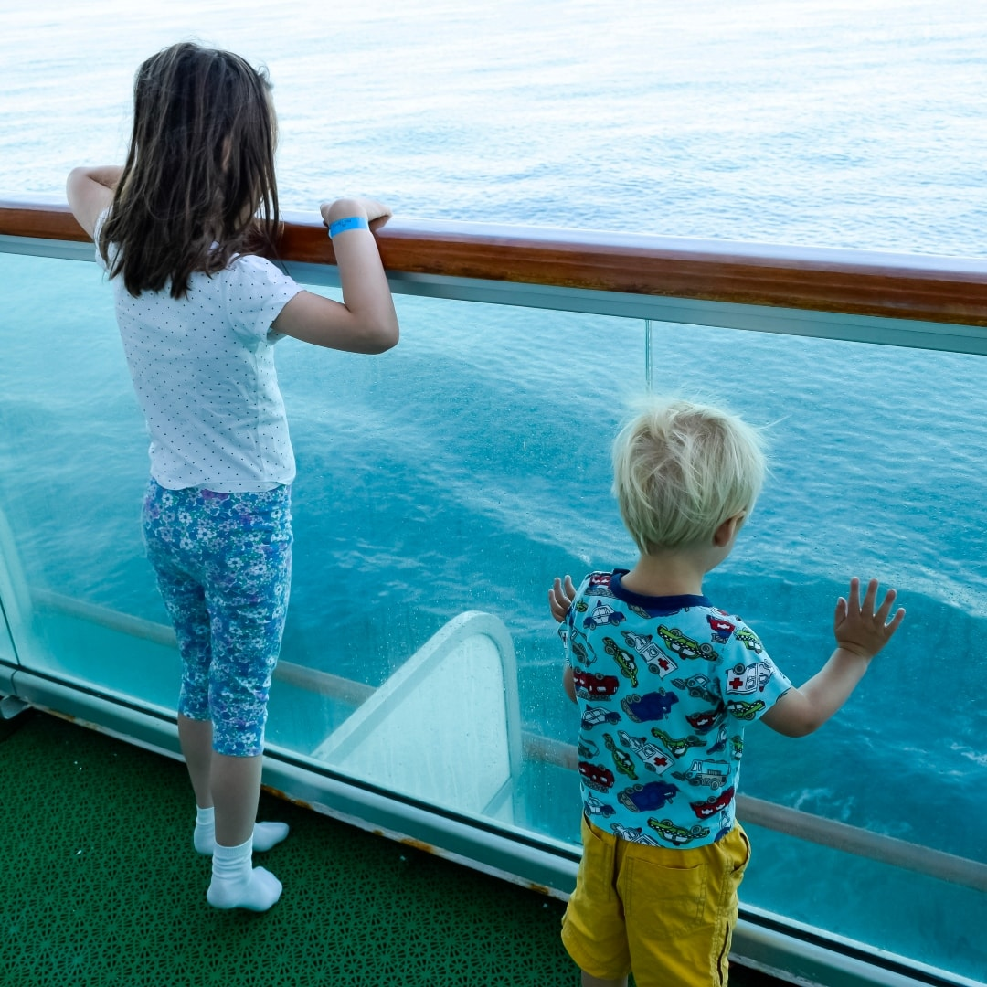 A photograph of a little boy and a little girl looking out to sea whilst aboard the P&O Cruises ship Azura - Snapshots Of Our Summer - Mrs H's favourite things