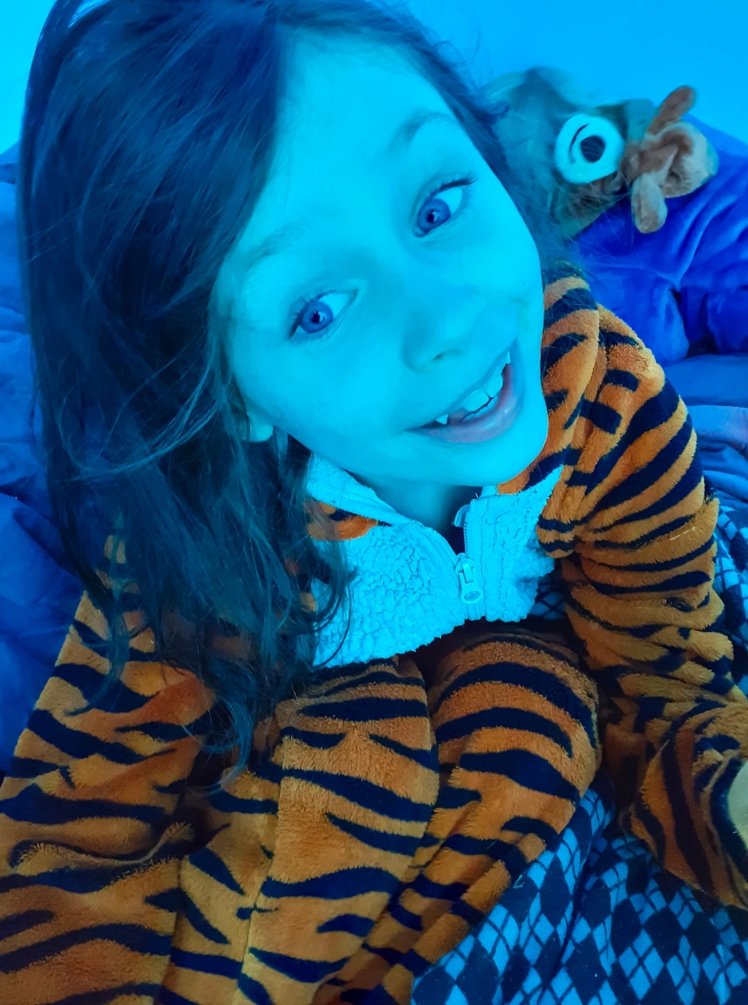 A little girl in a tiger onesie at Into The Trees festival 2019 - Into The Trees 2019 - An Idyllic Family Festival - Mrs H's favourite things