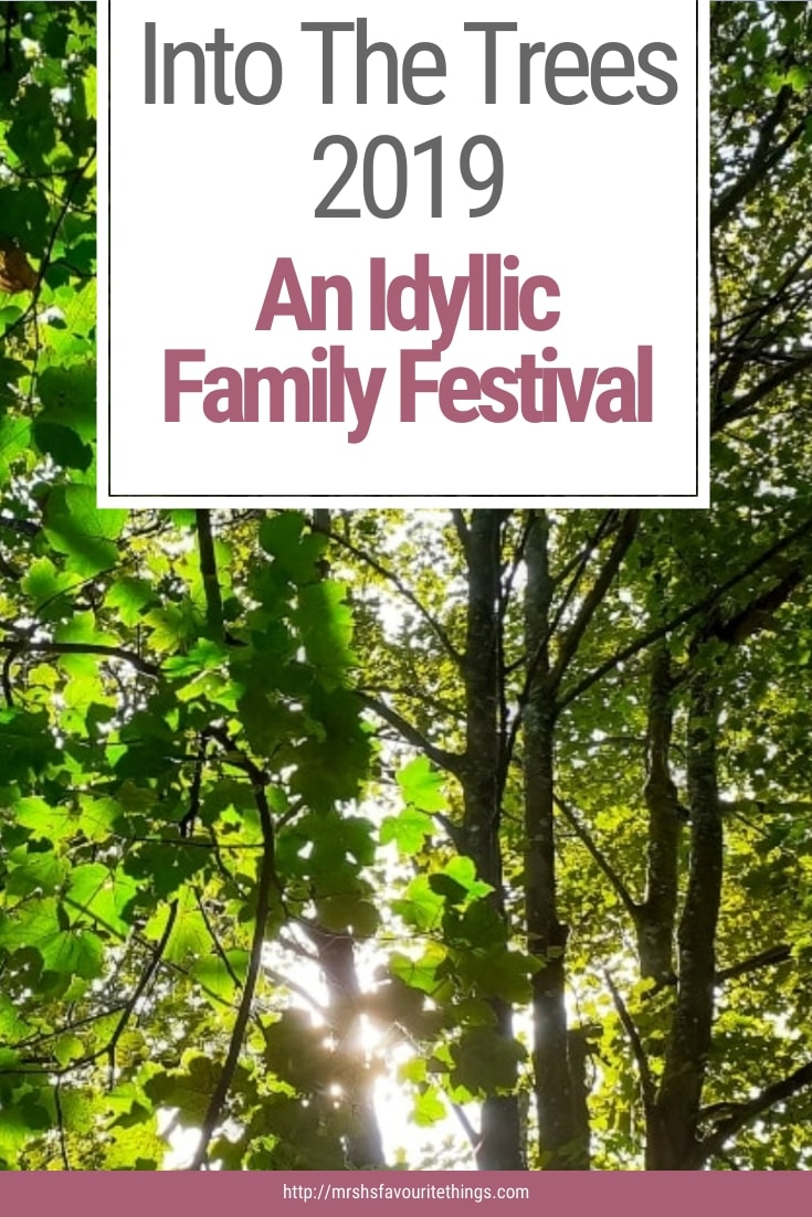 "A Pinterest friendly image of some trees with the text ""Into The Trees 2019 - An Idyllic Family Festival"" - Into The Trees 2019 - An Idyllic Family Festival - Mrs H's favourite things"